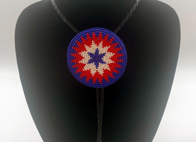 Beaded bolo tie; blue, red and white beads on black cord