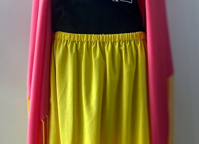 Dark Pink with shine in the fabric; yellow fringe; Made by Carolyn Nott