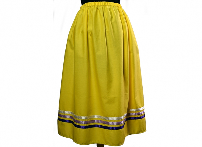 Yellow skirt with purple and white ribbons.
